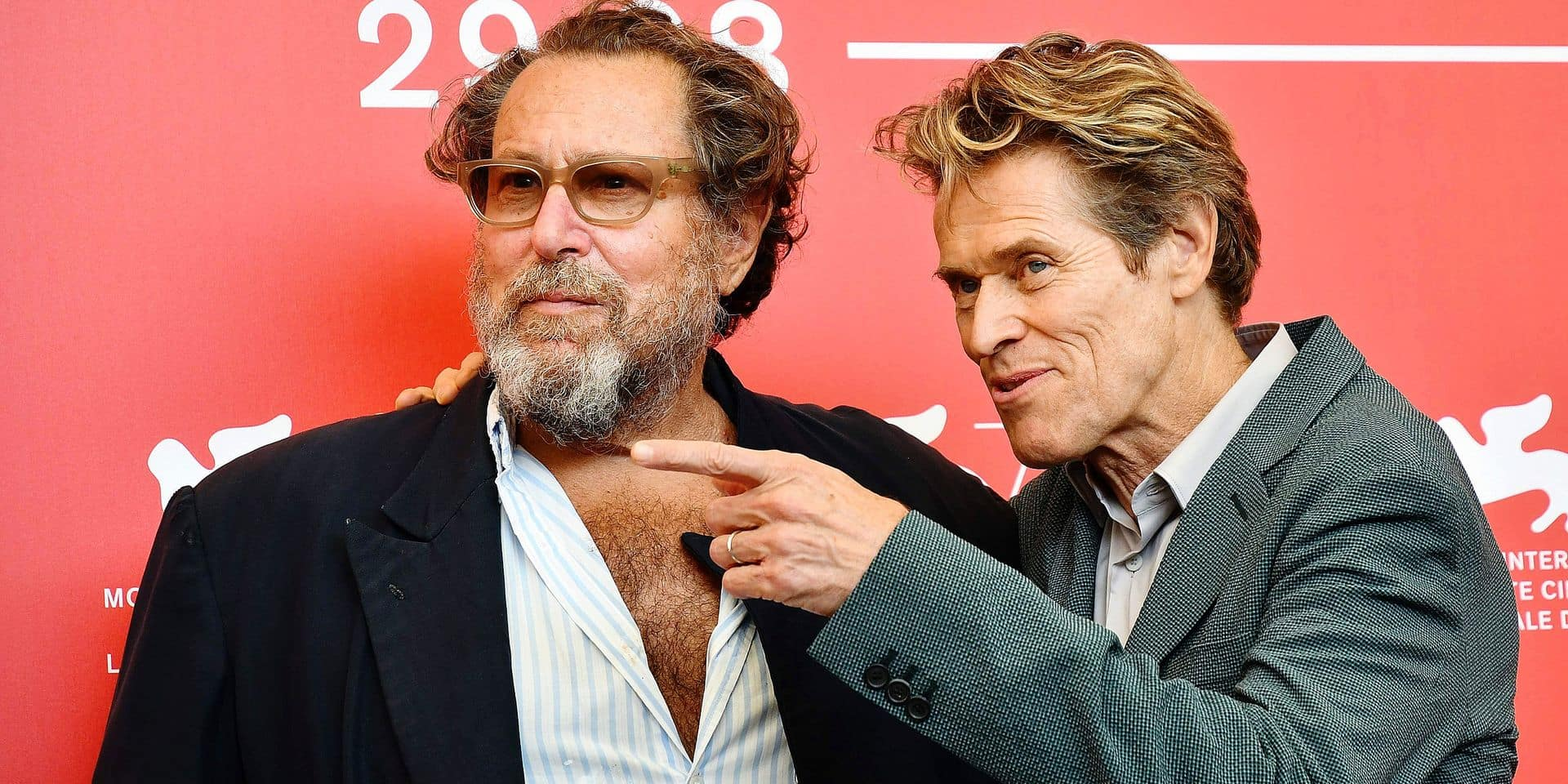 """Director Julian Schnabel (L) and actor Willem Dafoe attend a photocall for the film """"At Eternity's Gate"""" presented in competition on September 3, 2018 during the 75th Venice Film Festival at Venice Lido. (Photo by Alberto PIZZOLI / AFP)"""