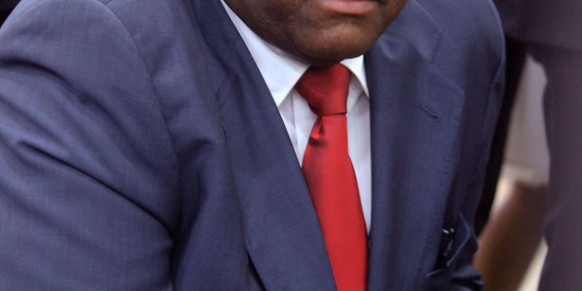 Former DRCongo warlord Jean-Pierre Bemba looks on as he arrives at Kinshasa airport on August 1, 2018, after more than 11 years abroad -- a decade of it behind bars. Bemba returned home on August 1, 2018 to huge crowds and police firing teargas, reflecting the country's high-voltage political mood. Bemba, 55, throwing down the gauntlet to his rival President Joseph Kabila, has vowed to contest twice-delayed elections due to take place on December 23. / AFP PHOTO / Papy MULONGO