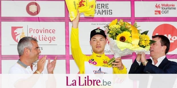 Belgian Loic Vliegen of Wanty-Gobert Cycling Team, wearing the yellow jersey of leader in the overall ranking, celebrates on the podium after the fifth and ladt stage of the Tour De Wallonie cycling race, 186,7 km from Couvin to Thuin, on Wednesday 31 July 2019. BELGA PHOTO BRUNO FAHY