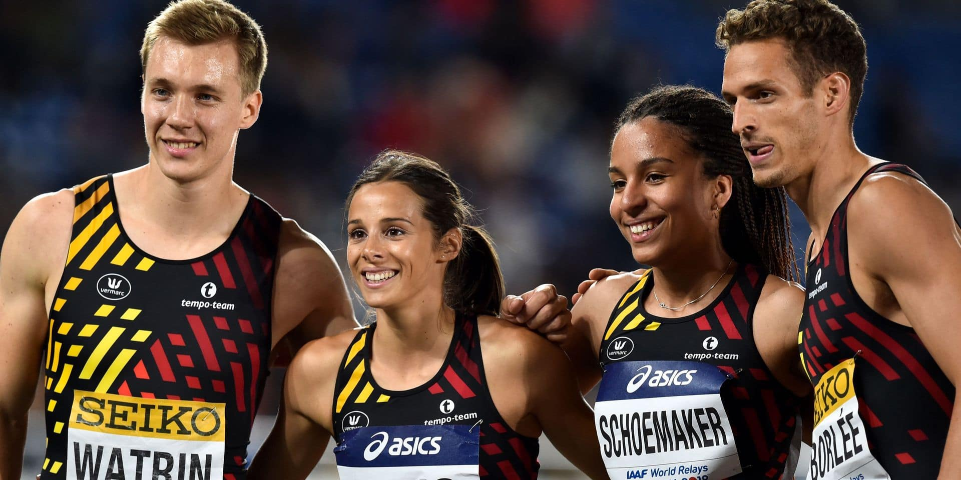 Julien Watrin (L), Camille Laus (2L), Liefde Schoemaker (2R), and Dylan Borlee (R) of Belgium pose after their competition of the mixed 4x400 metres relay at the IAAF World Relays athletics event at Nissan Stadium in Yokohama on May 11, 2019. (Photo by Kazuhiro NOGI / AFP)