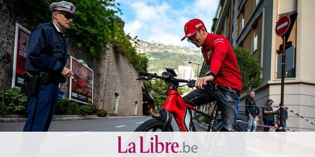 Ferrari's Monegasque driver Charles Leclerc arrives by bike to the paddock ahead of the first practice session at the Monaco street circuit on May 23, 2019 in Monaco, ahead of the Monaco Formula 1 Grand Prix. (Photo by ANDREJ ISAKOVIC / AFP)