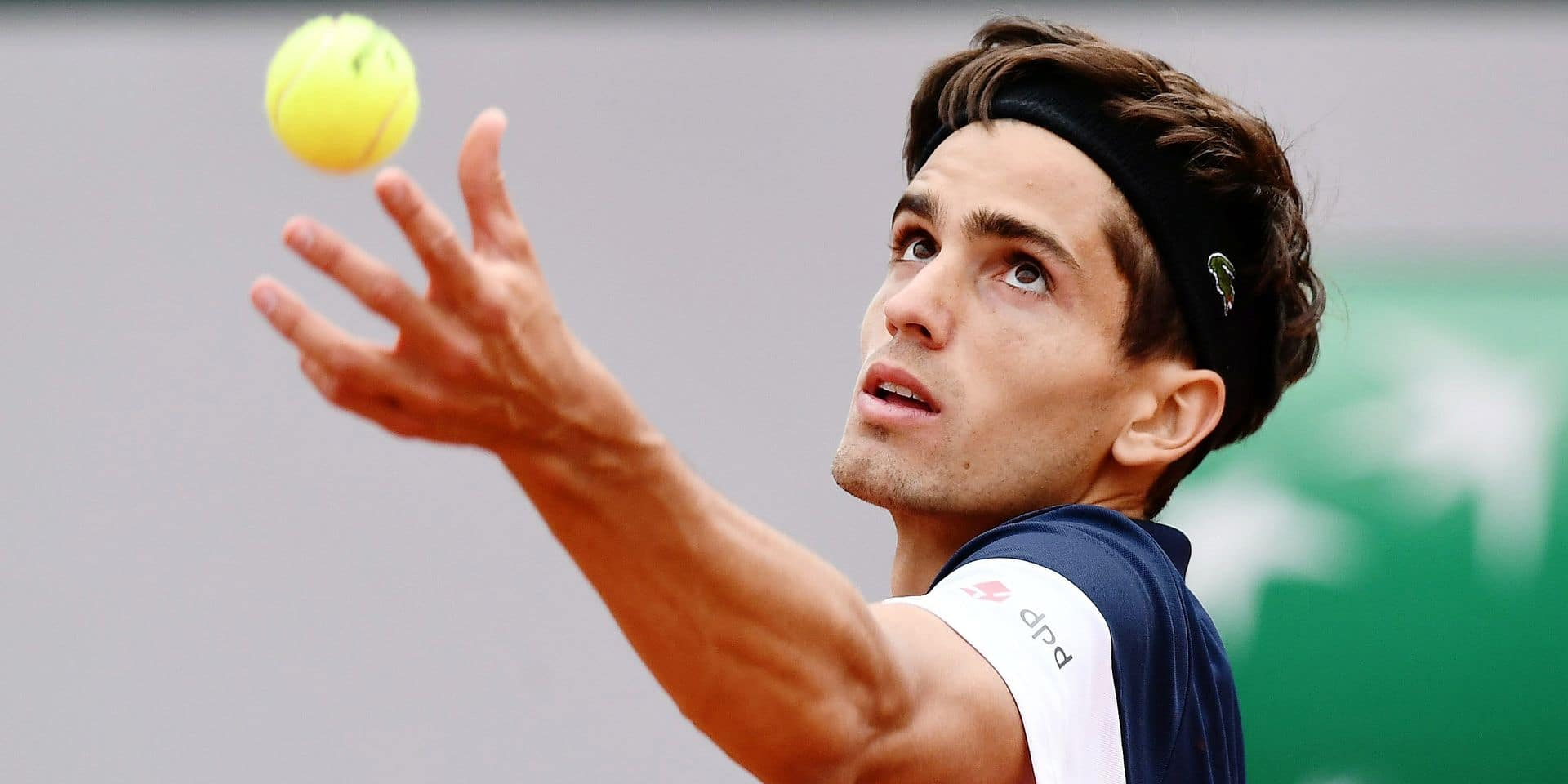 France's Pierre-Hugues Herbert eyes the ball as he serves to France's Benoit Paire during their men's singles second round match on day four of The Roland Garros 2019 French Open tennis tournament in Paris on May 29, 2019. (Photo by Philippe LOPEZ / AFP)