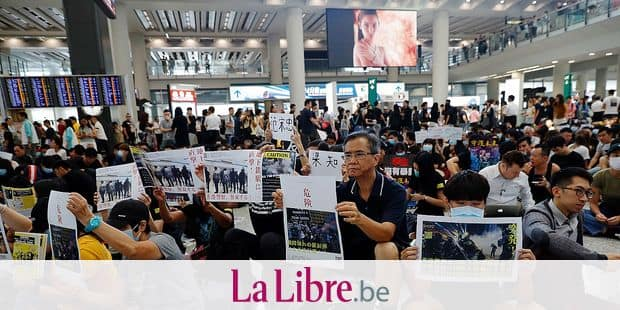 Protesters demonstrate at the airport in Hong Kong on Friday, Aug. 9, 2019. Pro-democracy protesters held a demonstration at Hong Kong's airport Friday even as the city sought to reassure visitors to the city after several countries issued travel safety warnings related to the increasing levels of violence surrounding the two-month-old protest movement. (AP Photo/Vincent Thian)