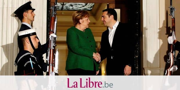Greek Prime Minister Alexis Tsipras, right, shakes hands with German Chancellor Angela Merkel during a welcome ceremony in Athens, Thursday Jan. 10, 2019. Merkel is in Greece for talks. (AP Photo/Thanassis Stavrakis)