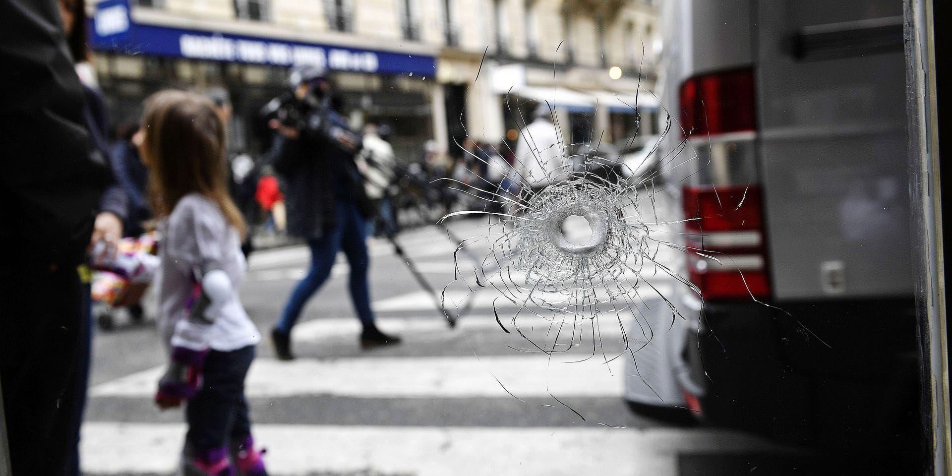 "A bullet hole, seen on the window of a cafe located at the crossroads between the streets Saint-Augustin and Monsigny, is pictured on May 13, 2018 in Paris, the day after a knifeman killed one man and wounded four other people. An attacker crying ""Allahu akbar""(God is Great) killed one person and wounded four others on the streets of Paris on May 12, 2018 evening before being shot dead by police. The Frenchman, born in 1997 in the Russian republic of Chechnya, was on the so-called ""S file"" of people suspected of radicalised views who could pose security risks, the sources said, though he did not have a criminal record. / AFP PHOTO / Eric FEFERBERG"