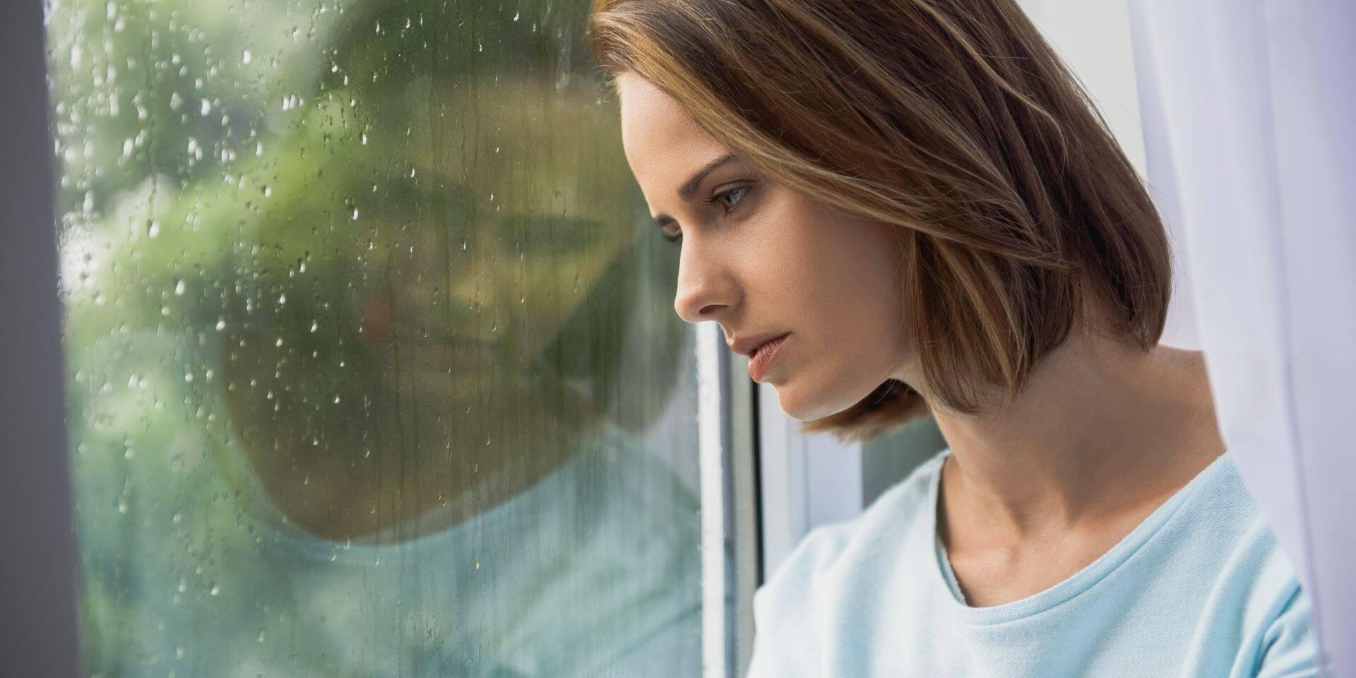 Sad,Woman,Sitting,Indoors,While,Raining
