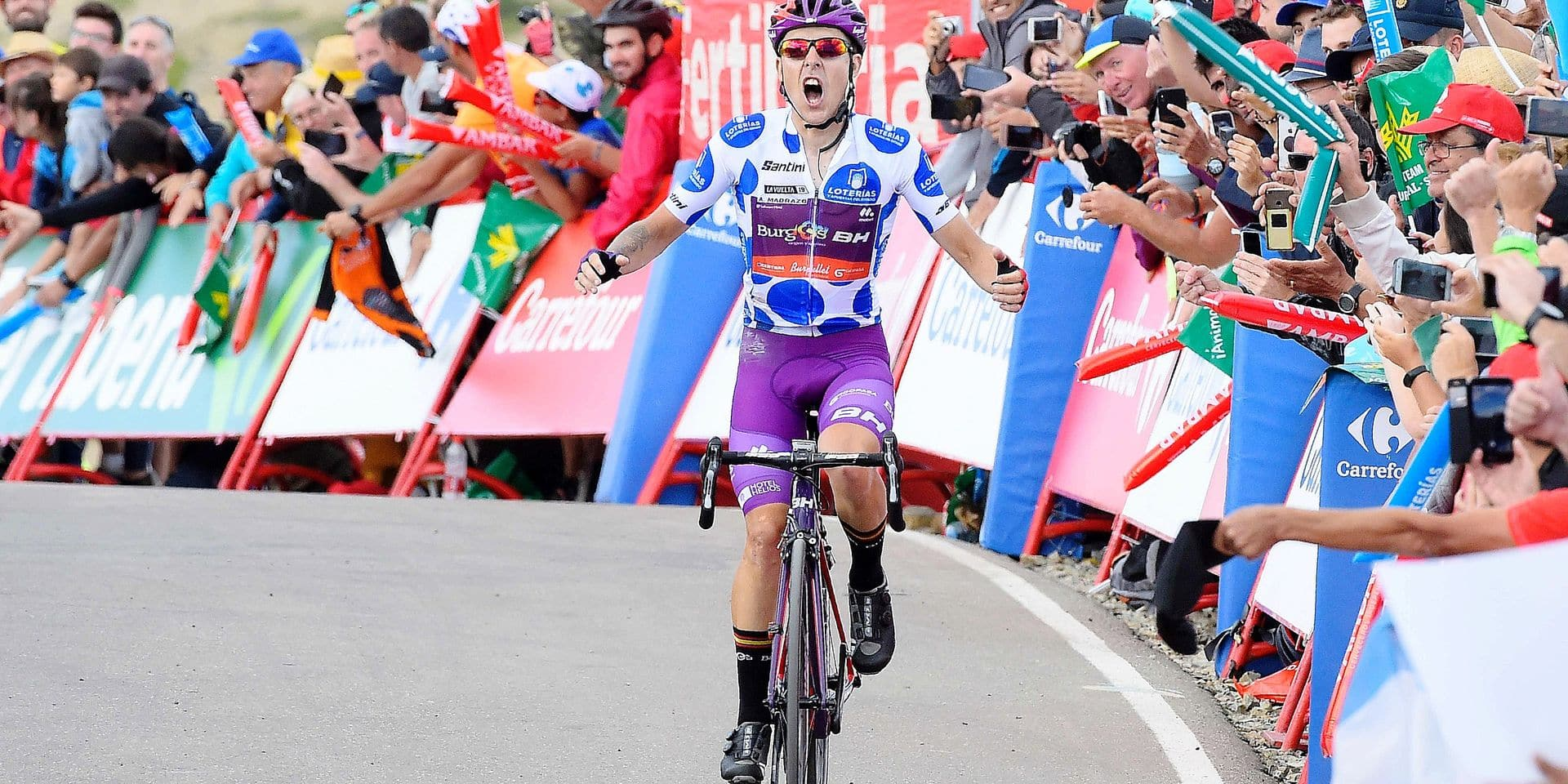 Team Burgos - BH rider Spain's Angel Madrazo wins the fifth stage of the 2019 La Vuelta cycling tour of Spain, a 170,7 km race from L'Eliana and Alto de Javalambre, on August 28, 2019 in Javalambre. (Photo by JOSE JORDAN / AFP)
