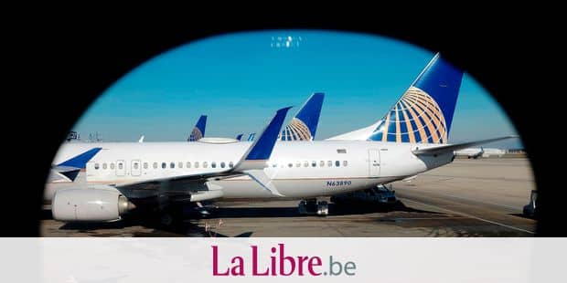 FILE - In this Nov. 22, 2017, file photo taken through an aircraft passenger window, United Airlines planes are parked at a terminal at O'Hare International Airport in Chicago. United Continental Holdings, Inc. reports earnings Tuesday, April 17, 2018. (AP Photo/Kiichiro Sato, File)