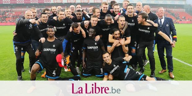 Club Brugge's team celebrate their new champion title during the Jupiler Pro League match between Standard de Liege and Club Brugge, in Liege, Sunday 13 May 2018, on day nine (out of ten) of the Play-Off 1 of the Belgian soccer championship. BELGA PHOTO BRUNO FAHY