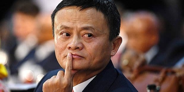 Co-founder of China's Alibaba Jack Ma gestures as he attends an international investment conference in Johannesburg on October 26, 2018. - South Africa's President Cyril Ramaphosa has wooed investors to the recession-hit country, assuring them their money would be safe amid fears sparked by government plans to expropriate white-owned land without compensation. Shortly after he took over from scandal-tainted Jacob Zuma in February, Ramaphosa launched an ambitious drive to raise some $100 billion in new investment over the next five years. (Photo by STRINGER / AFP)