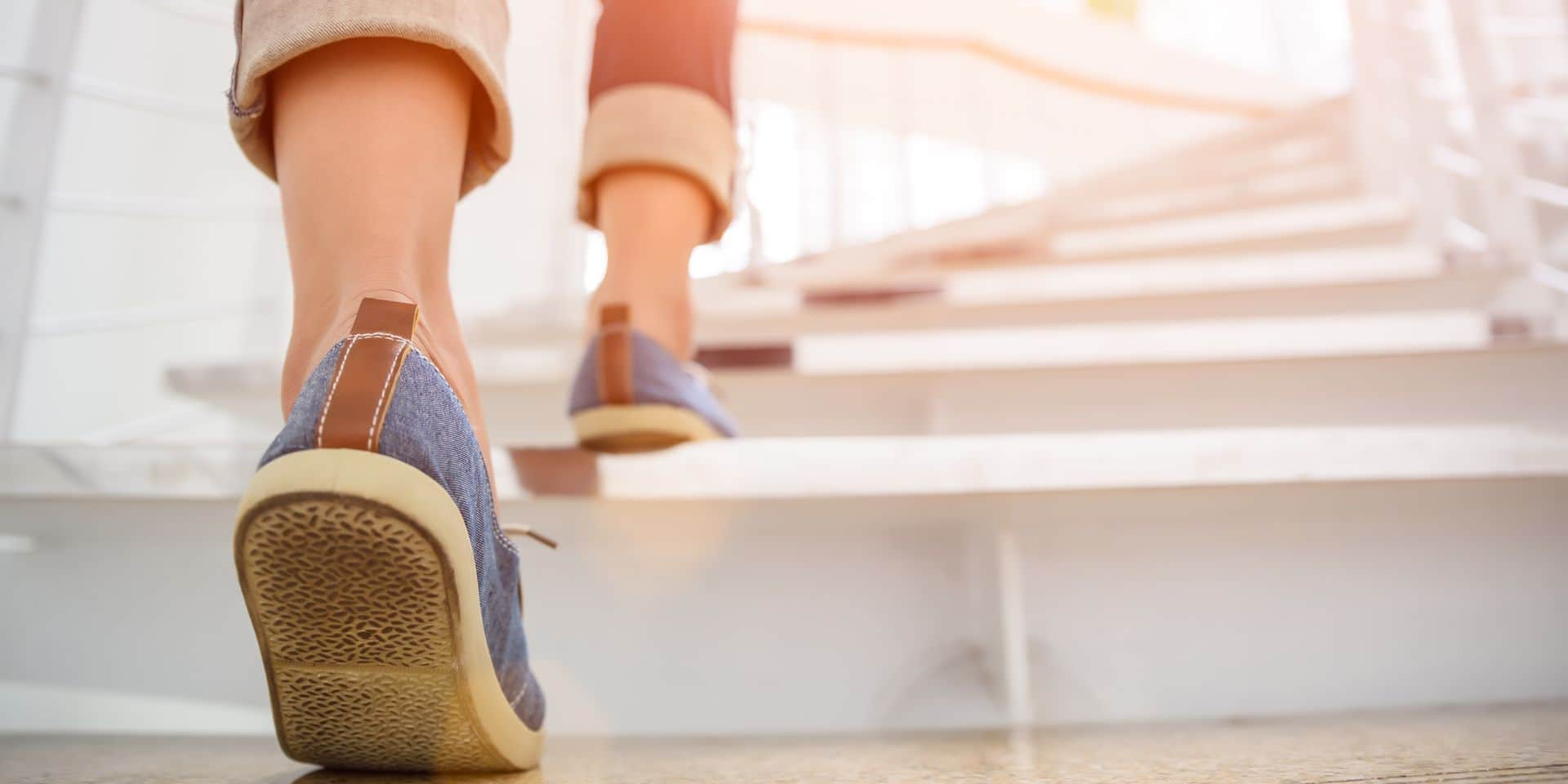 Young,Adult,Woman,Walking,Up,The,Stairs,With,Sun,Sport