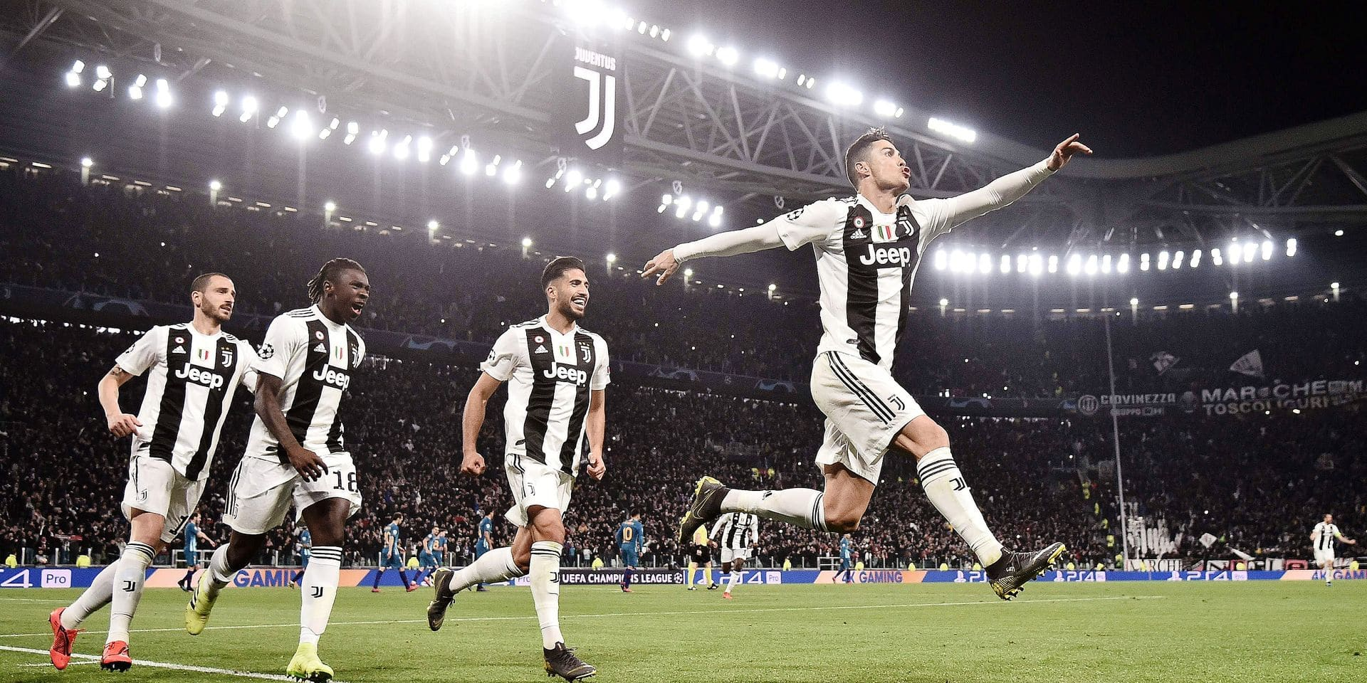 Juventus' Portuguese forward Cristiano Ronaldo (R) celebrates after scoring 3-0 during the UEFA Champions League round of 16 second-leg football match Juventus vs Atletico Madrid on March 12, 2019 at the Juventus stadium in Turin. (Photo by Marco BERTORELLO / AFP)