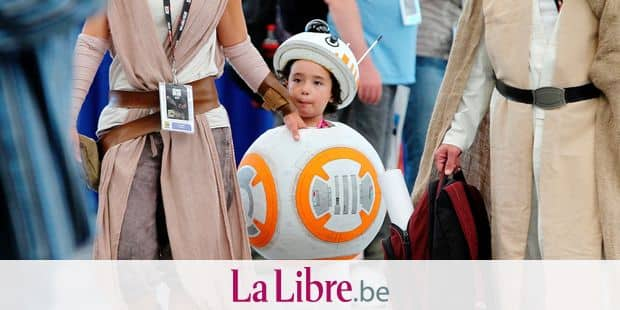 (FILES) In this file photo taken on July 22, 2016 Anya Klam, 5, plays the part of BB-8 from Star Wars during Comic-Con International 2016 in San Diego, California. - From Peter Parker's run-in with a radioactive spider to Superman fleeing an exploding Krypton: comic book fans love a good origin story. So when 135,000 geeks and nerds invade San Diego next week for the 50th edition of Comic-Con -- the world's largest celebration of pop culture -- the event's humble beginnings will be a hot topic of discussion. (Photo by Bill Wechter / AFP)