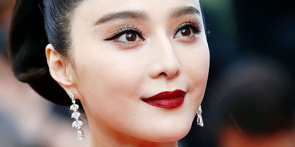 FILE - In this May 24, 2017, file photo, Fan Bingbing poses for photographers as she arrives for the screening of the film The Beguiled at the 70th international film festival, Cannes, southern France. Chinese actress Fan Bingbing has disappeared from social media amid rumors she is the target of a tax evasion investigation and that she, her brother and boyfriend have been barred from leaving China. (AP Photo/Alastair Grant, File)