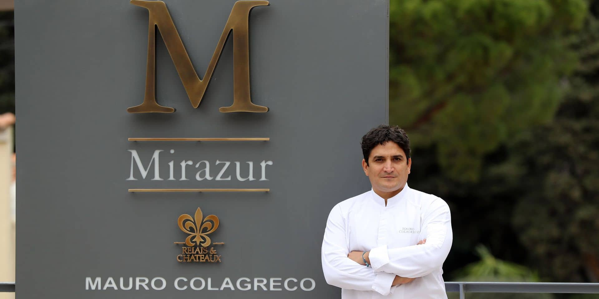 """(FILES) In this file photo taken on February 15, 2018 Argentinian chief Mauro Colagreco poses in front of """"Mirazur"""" restaurant on the French riviera city of Menton. - Colagreco was awarded a third Michelin star during the Michelin guide award ceremony on January 21, 2019. (Photo by VALERY HACHE / AFP)"""