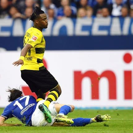 115 April 2018, Germany, Gelsenkirchen: Soccer, German Bundesliga, FC Schalke 04 vs Borussia Dortmund at the Veltins Arena: Michy Batshuayi of Dortmund gets injured in a tackle with Benjamin Stambouli (l) of Schalke. Photo: Ina Fassbender/dpa - IMPORTANT NOTICE: Due to the German Football League·s (DFL) accreditation regulations, publication and redistribution online and in online media is limited during the match to fifteen images per match Reporters / DPA