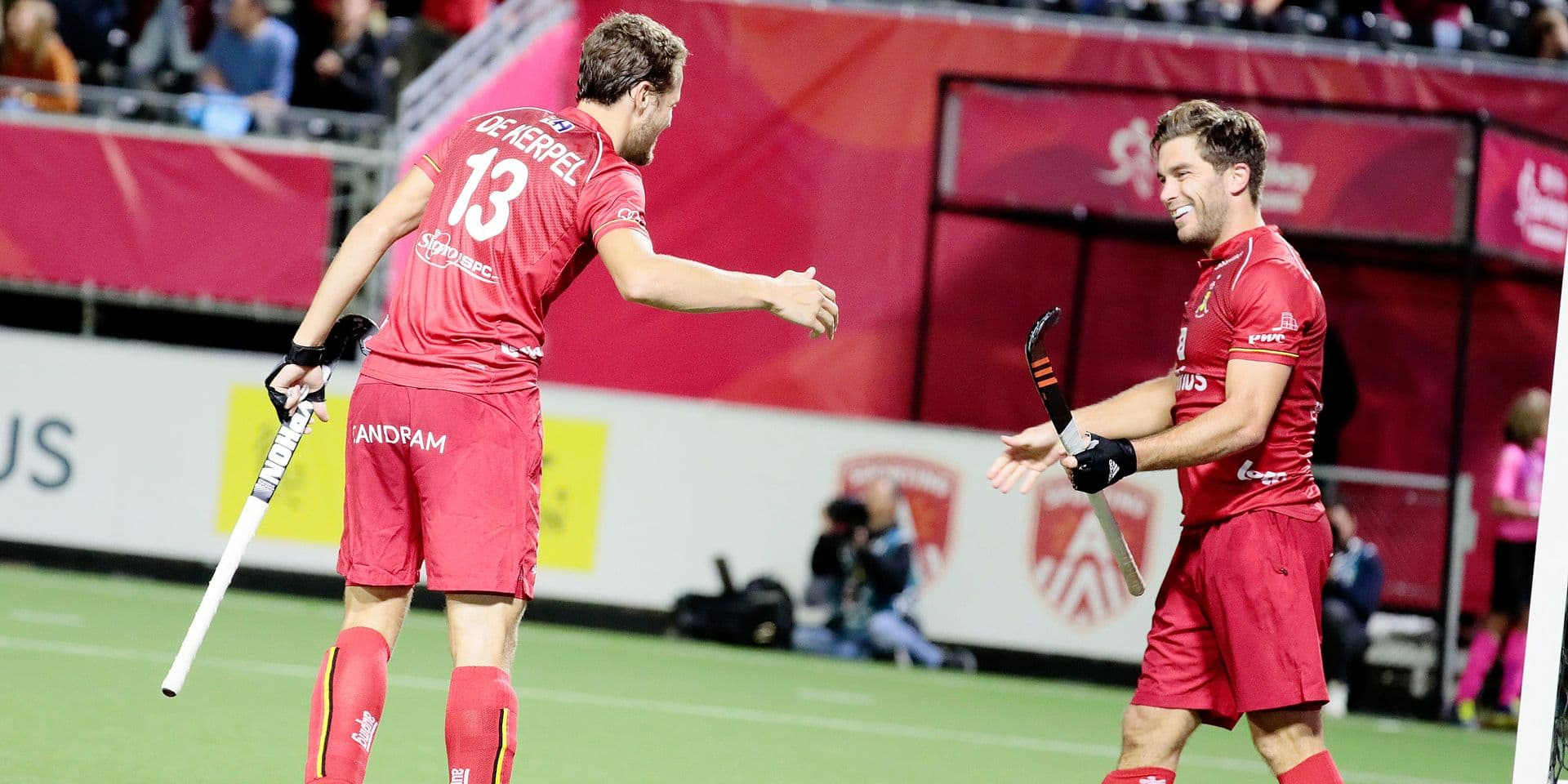 Belgium's Cedric Charlier, right, is congratulated by Belgium's Nicolas De Kerpel after scoring his sides fifth goal during a men's European Championship field hockey match between Belgium and Wales at the Wilrijkse Plein, Antwerp, Belgium, Tuesday, Aug. 20, 2019. (AP Photo/Virginia Mayo)