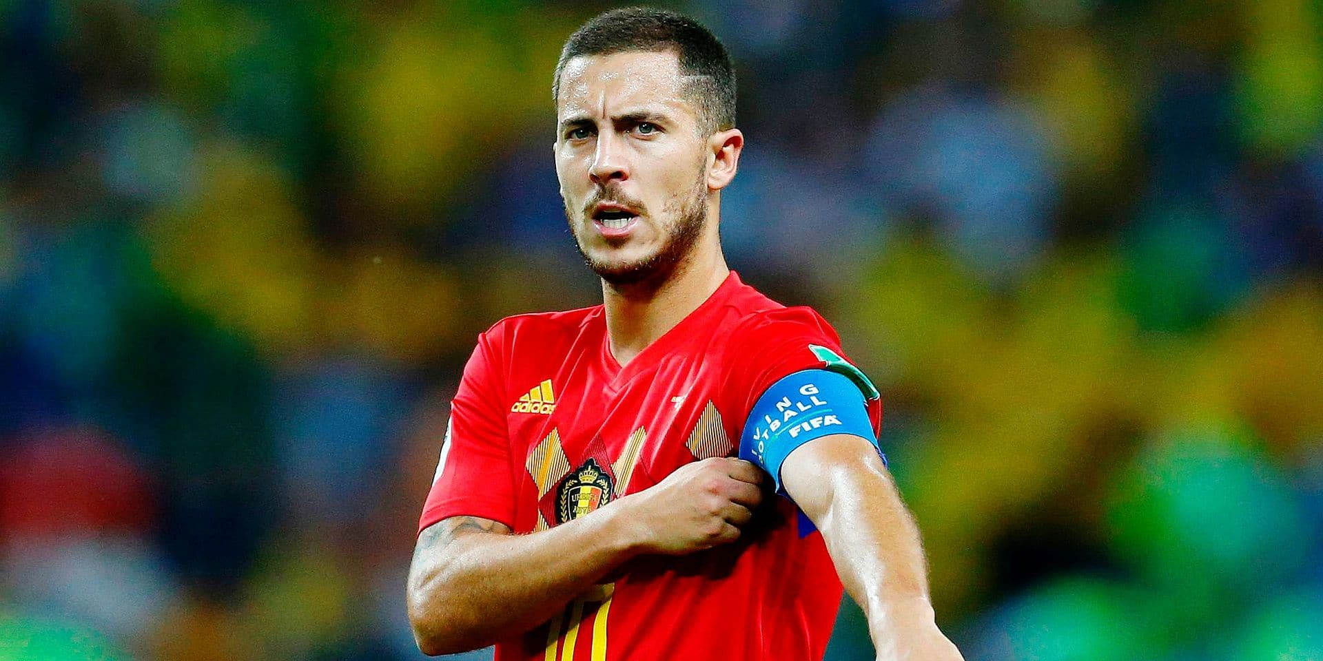 Belgium's forward Eden Hazard adjusts his captain's band during the Russia 2018 World Cup quarter-final football match between Brazil and Belgium at the Kazan Arena in Kazan on July 6, 2018. / AFP PHOTO / BENJAMIN CREMEL / RESTRICTED TO EDITORIAL USE - NO MOBILE PUSH ALERTS/DOWNLOADS