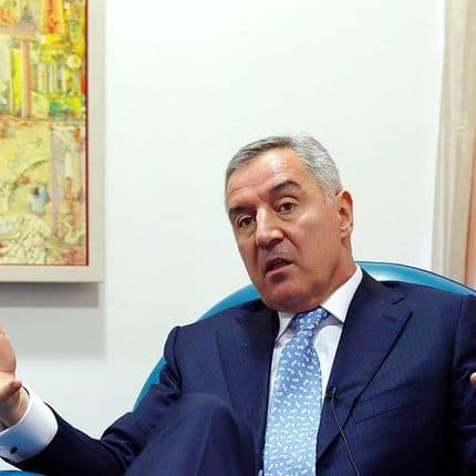 In this Tuesday, March 14, 2017 file photo, Montenegro's former Prime Minister Milo Djukanovic speaks during an interview with The Associated Press, in Podgorica, Montenegro. Montenegro's ruling party says its leader Milo Djukanovic, who took the Balkan country to independence and into NATO in defiance of Russia, will run for the presidency in next month's election. (AP Photo/Darko Vojinovic, File)