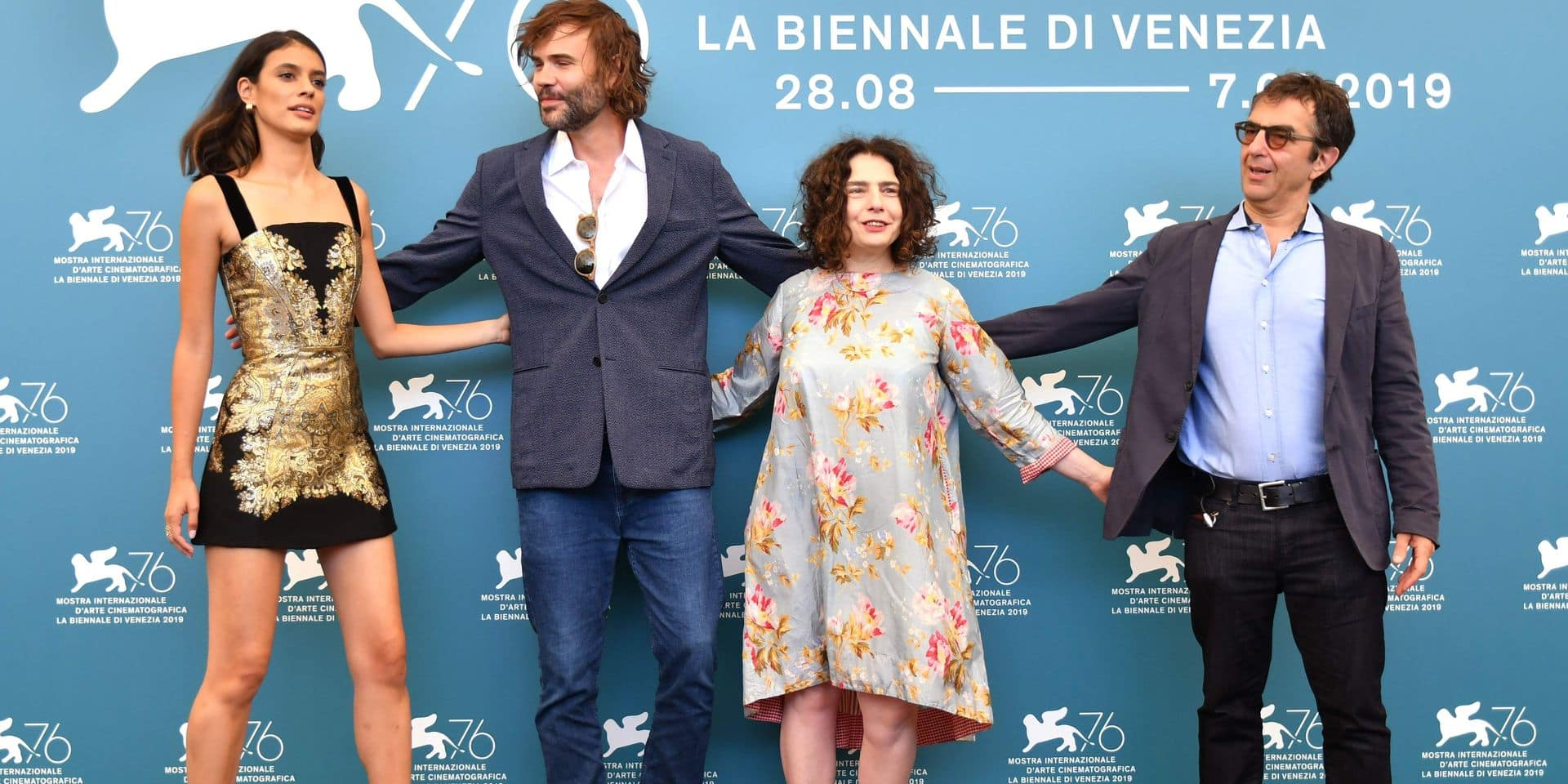 """(From L) Brazilian actress Laysla De Oliveira, Canadian actor Rossif Sutherland, Lebanese actress Arsinee Khanjian and Canadian director Atom Egoyan pose during the photocall for the film """"Guest of Honour"""", presented in competition on September 3, 2019 during the 76th Venice Film Festival at Venice Lido. (Photo by Alberto PIZZOLI / AFP)"""
