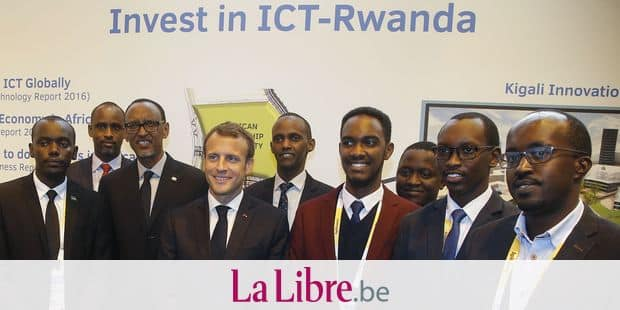Rwanda's President Paul Kagame, (3rdL) and France's President Emmanuel Macron (4thL) pose with business men of Rwanda at the VivaTech gadget show in Paris, on May 24, 2018. Macron urged Facebook CEO and the bosses of other tech companies accused of hoovering up personal data while avoiding taxes to use their clout for global good. Around 60 industry leaders travelled to Paris for talks with the French leader about improving the lives of workers in the gig economy and being better corporate citizens generally. / AFP PHOTO / POOL / Michel Euler