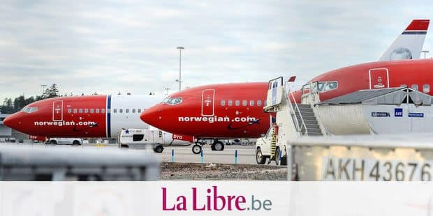 Aircrafts of Norwegian low-cost airline Norwegian Air Shuttle are parked at Arlanda airport in Stockholm, Sweden, on March 5, 2015, as pilots of the airline staged a strike. The Norwegian pilots, employed by its subsidiary Norwegian Air Norway, want to maintain tight organisational links with the parent company in the hope of safeguarding their jobs and to standardise salary conditions for all pilots employed in the various Scandinavian subsidiaries. AFP PHOTO / TT NEWS AGENCY / JOHAN NILSSON +++ SWEDEN OUT +++ / AFP PHOTO / TT NEWS AGENCY / JOHAN NILSSON