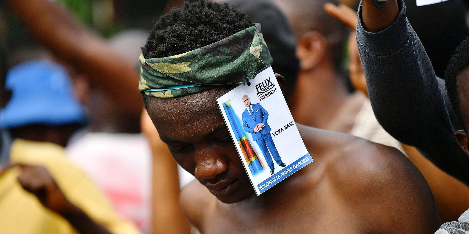 """A supporter of Felix Tshisekedi, DR Congo's opposition politician declared winner of the December's presidential poll, demonstrates in the streets of Kinshasa January 19, 2019 as they wait for an expected ruling in a case of another opposition candidate challenging the controversial result announced by the Commission electorale nationale independante (CENI). - The African Union (AU) has said there were """"serious doubts"""" over the outcome, and said heads of state and government agreed to """"urgently dispatch"""" a high-level delegation to DRC. (Photo by TONY KARUMBA / AFP)"""
