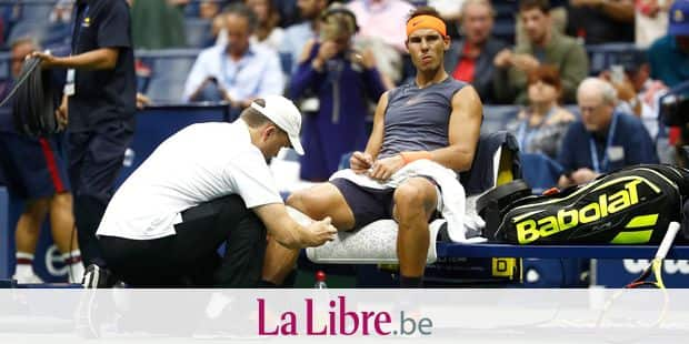 NEW YORK, NY - SEPTEMBER 07: Rafael Nadal of Spain is looked at by the trainer during his men's singles semi-final match against Juan Martin del Potro of Argentina on Day Twelve of the 2018 US Open at the USTA Billie Jean King National Tennis Center on September 7, 2018 in the Flushing neighborhood of the Queens borough of New York City. Julian Finney/Getty Images/AFP == FOR NEWSPAPERS, INTERNET, TELCOS & TELEVISION USE ONLY ==
