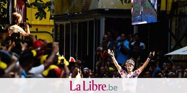 France's Julian Alaphilippe, wearing the best climber's polka dot jersey, celebrates as he crosses the finish line to win the 16th stage of the 105th edition of the Tour de France cycling race, between Carcassonne and Bagneres-de-Luchon, southwestern France, on July 24, 2018. / AFP PHOTO / Philippe LOPEZ