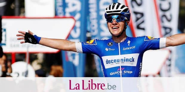 Belgian cyclist Remco Evenepoel, 19, celebrates as he crosses the finish line to win the men's Clasica cycling event in San Sebastian, Basque Country, northern Spain, 03 August 2019. The race covers around 227 km. EFE/ Javier Etxezarreta