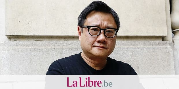 "Singapore's director Eric Khoo poses prior to the release of his latest movie 'Hotel Singapura' (""In the room""), on June 21, 2016 in Paris. / AFP PHOTO / PATRICK KOVARIK"