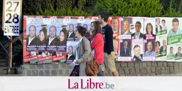 20140525 - LIMAL, BELGIUM: Illustration picture shows campaign posters outside a polling station in Limal during the federal, regional and European elections in Belgium, Sunday 25 May 2014. BELGA PHOTO ERIC LALMAND