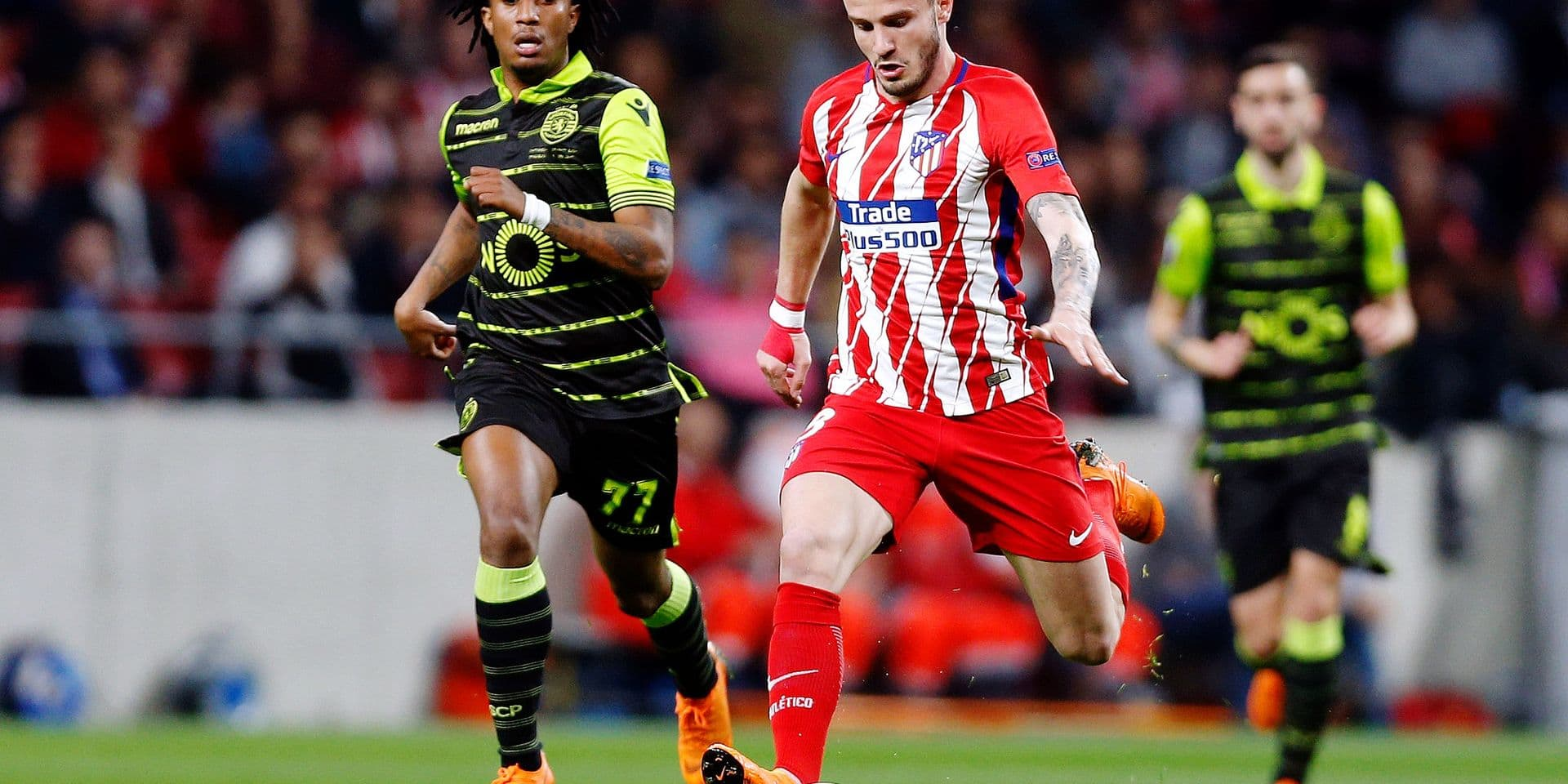 Atletico's Saul Niguez runs with the ball followed by Sporting's Gelson Martins, left, during the Europa League quarterfinal first leg soccer match between Atletico Madrid and Sporting CP at the Metropolitano stadium in Madrid, Thursday, April 5, 2018. (AP Photo/Francisco Seco)