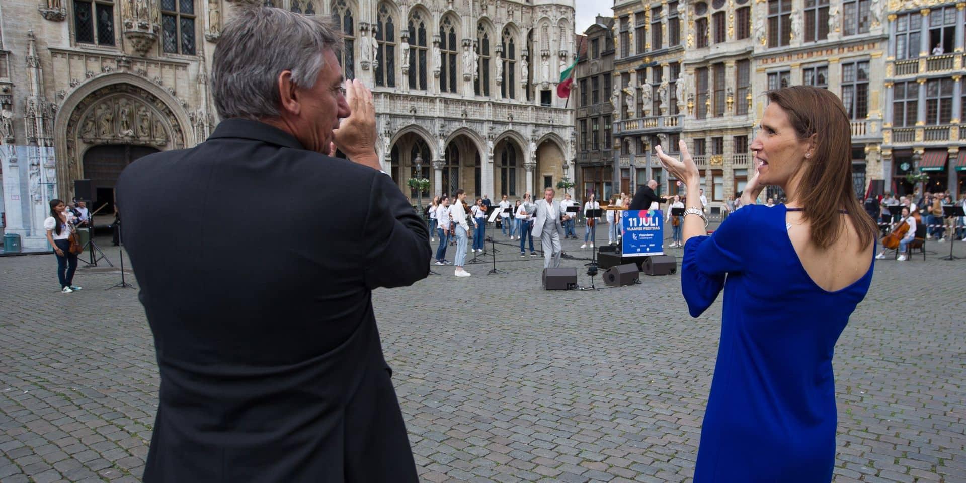 Sophie Wilmès et Jan Jambon assistent ensemble à un concert surprise de Will Tura pour la fête de la Communauté flamande