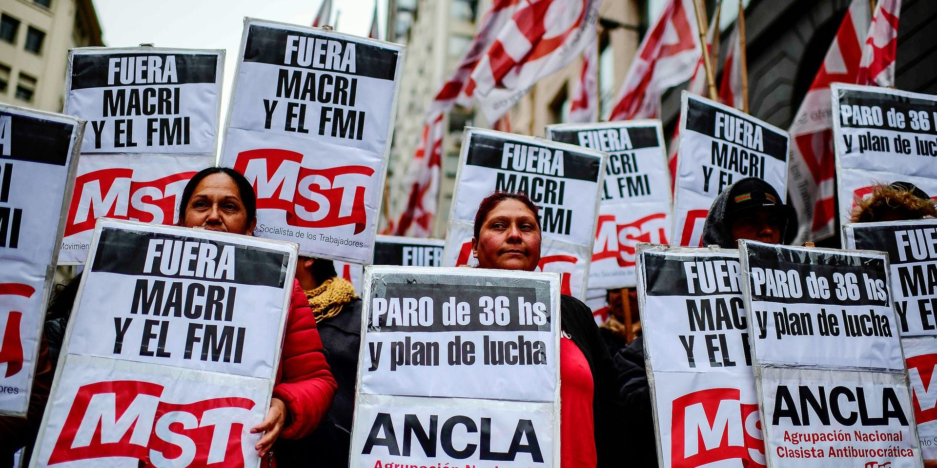 Demonstrators march along Corrientes avenue against the economic policies of the government of Argentine President Mauricio Macri during a protest on August 30, 2019, in Buenos Aires. - Recession-hit Argentina has been whipped by market volatility since business-friendly Argentine President Mauricio Macri was trounced in party primaries three weeks ago by leftist challenger Alberto Fernandez. (Photo by RONALDO SCHEMIDT / AFP)
