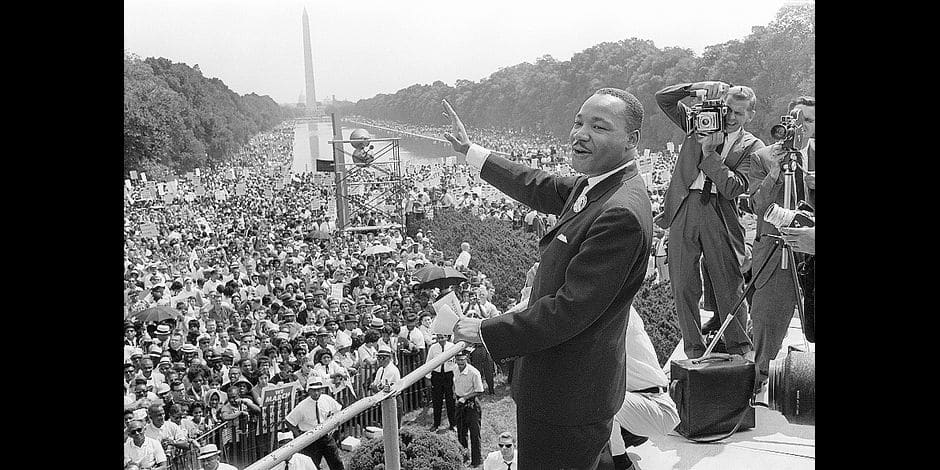 """(FILES) In this file photo taken on August 28, 1963 The civil rights leader Martin Luther King (C) waves to supporters during the """"March on Washington"""" on the Mall in Washington, DC. Towards the end of his life, Martin Luther King Jr. lamented that his dream had """"turned into a nightmare."""" The US civil rights leader was a weary man when he was cut down by an assassin's bullet at the age of 39 on the balcony of a motel in Memphis, Tennessee on April 4, 1968. / AFP PHOTO / -"""