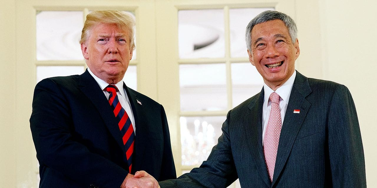 President Donald Trump shakes hands as he meets with Singapore Prime Minister Lee Hsien Loong ahead of a summit with North Korean leader Kim Jong Un, Monday, June 11, 2018, in Singapore. (AP Photo/Evan Vucci)