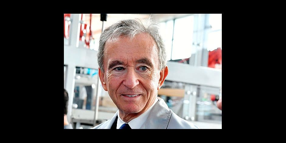 (FILES) In this file photo taken on October 18, 2017 World's biggest luxury goods company LVMH's CEO Bernard Arnault visits the world leader for the production of Cognac Hennessy's new bottling plant in Salles-d'Angles. Amazon chief Jeff Bezos is now the world's richest person, having snatched the top spot from Microsoft founder Bill Gates who slips to second place, according to Forbes magazine's annual billionaires list published on March 6, 2018 .Legendary investor Warren Buffett held on to his number-three ranking, followed by French industrialist Bernard Arnault, who jumped to fourth-richest person from his previous number 11 spot, mostly thanks to euro strength against the dollar, the magazine said. / AFP PHOTO / GEORGES GOBET