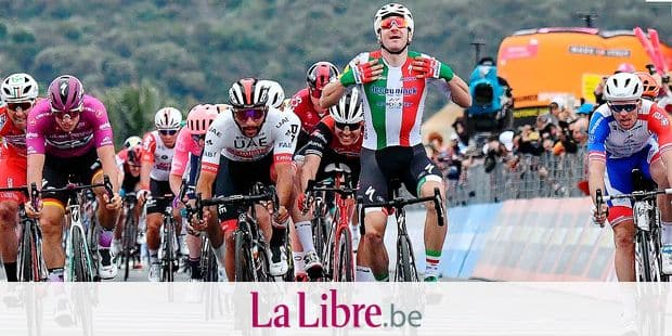 Spain's Fernando Gaviria, center left, and Italy's Elia Viviani, 2nd from right, sprint during the third stage of the Giro d'Italia, tour of Italy cycling race from Vinci to Orbetello, Monday, May 13, 2019. Fernando Gaviria has been awarded victory of the third stage of the Giro d'Italia after Elia Viviani was relegated for an irregular sprint. Slovenian cyclist Primoz Roglic remained in overall lead of the race. (Alessandro Di Meo/ANSA via AP)