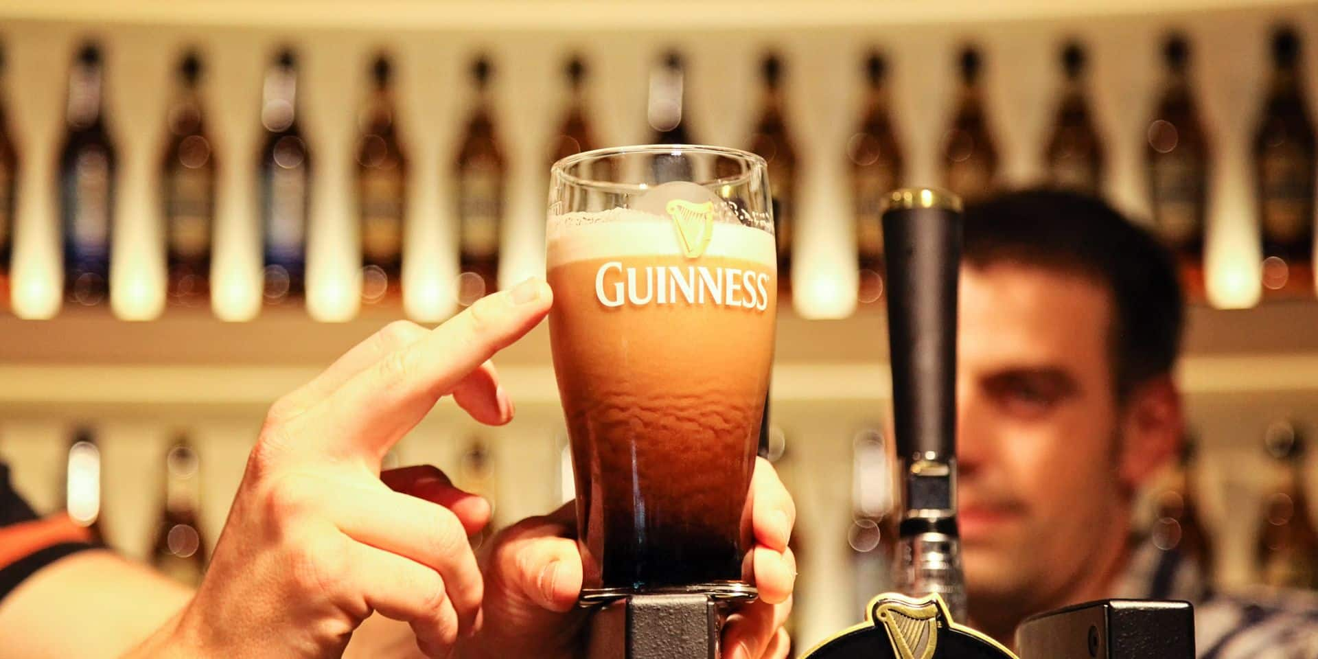 Pint,Of,Guinness,Placed,On,Top,Of,Draft,Counter,At